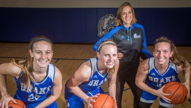 Drake women's basketball coach Jennie Baranczyk, rear, has the Bulldogs scoring the most points (82.3 per game), shooting the best from the floor (48.9 percent) and from the free-throw line (76.2) in the Missouri Valley Conference.