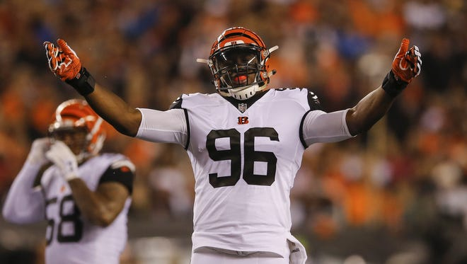 Bengals defensive end Carlos Dunlap pumps up the crowd during a Sept. 29 win over the Miami Dolphins.