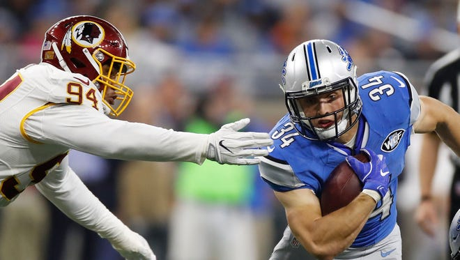 Preston Smith of the Washington Redskins attempts to stop Zach Zenner of the Detroit Lions during the first half at Ford Field on Oct. 23, 2016 in Detroit.