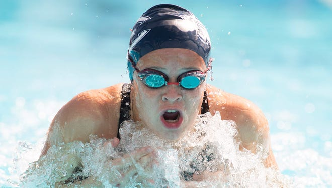Estero's Mikayla Puckett swims the 100 yard breaststroke during the FHSAA Class 3A Swimming and Diving Finals at Sailfish Splash Waterpark in Stuart on Friday, Nov. 4, 2016.  CQ: Mikayla Puckett