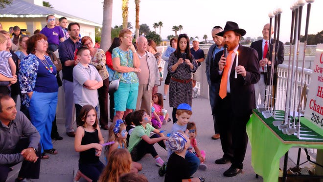 This image was taken at the Community Public Menorah Lighting hosted by the Chabad Jewish Center of Martin and St. Lucie at Tradition Town Square in Port St. Lucie on Dec. 17, 2014.