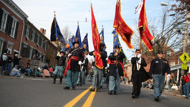 Color guard units march down Baltimore Street in Gettysburg during a previous Remembrance Day parade.