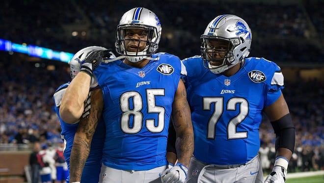 Lions tight end Eric Ebron, left, celebrates a touchdown with offensive lineman Laken Tomlinson (72) against the Jaguars on Nov. 20, 2016 in Detroit.