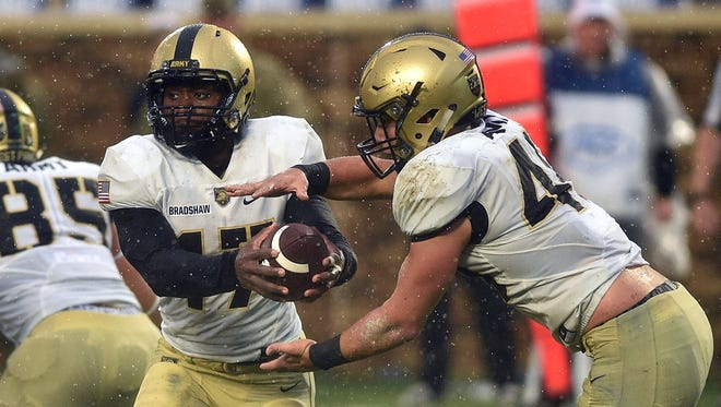 Ahmad Bradshaw #17 hands off to Andy Davidson #40 of the Army Black Knights during their game against the Duke Blue Devils at Wallace Wade Stadium on October 8, 2016 in Durham, North Carolina.