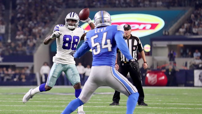 Dez Bryant throws a touchdown pass to Jason Witten against DeAndre Levy and the Detroit Lions in the third quarter.