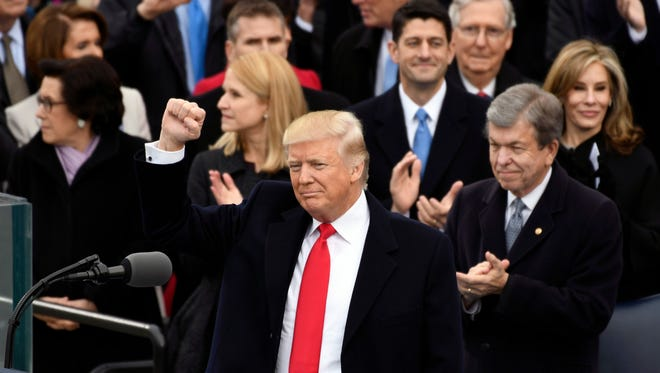 President Trump waves to the crowd after taking the oath of office on Jan. 20, 2017.
