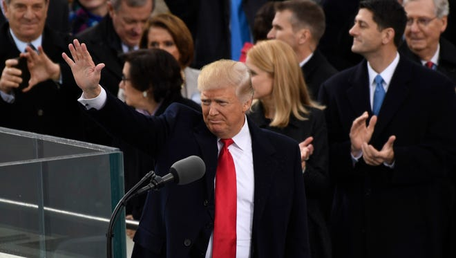 President Donald Trump acknowledges the crowd after speaking during his Inauguration.