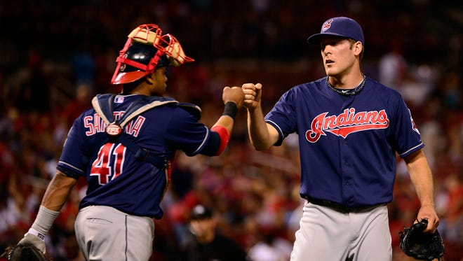 Cleveland Indians reliever Nick Hagadone (right) celebrates a victory with catcher Carlos Santana over St. Louis in 2012.