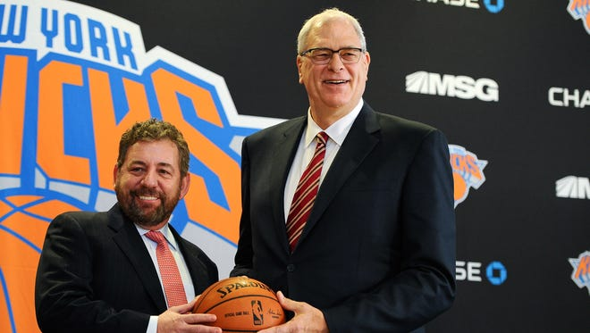 James Dolan, L, Executive Chairman of Madison Square Garden, stands with Phil Jackson during the press conference to announce Jackson as President of the New York Knicks at Madison Square Garden on March 18, 2014 in New York City.