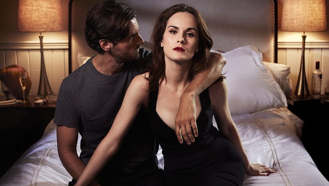"""Michelle Dockery, as con artist Letty Raines, and Juan Diego Botto, who plays charismatic hit man Javier Pereira, are shown in a scene from the TNT drama series, """"Good Behavior."""""""