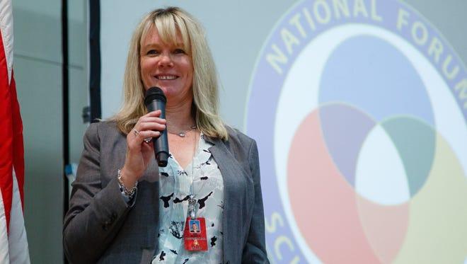 "Desert Springs Middle School Principal Kiela Snider speaks at the school's ""Schools to Watch Celebration."""