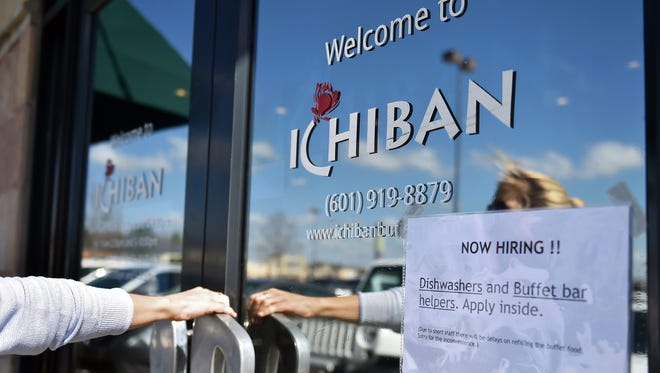 A patron walks Feb. 24, 2017, into Ichiban Sushi and Chinese Buffet in Flowood, Miss., two days after 55 people were detained in multiple raids at Mississippi restaurants, including this one.