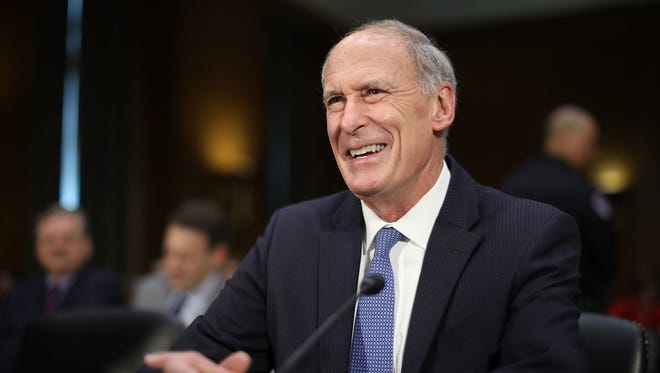 Former U.S. Senator Dan Coats prepares to testify during his confirmation hearing before the Senate Select Intelligence Committee to be the next Director of National Intelligence in the Dirksen Senate Office Building on Capitol Hill February 28, 2017 in Washington, DC. A former ambassador to Germany and a two-time Republican senator from Indiana, Coats is President Donald Trump's choice to be America's top intelligence official.