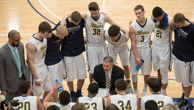 Whitman College men''s basketball coach Eric Bridgeland talks to the team during a timeout in a Feb. 23 victory against George Fox.