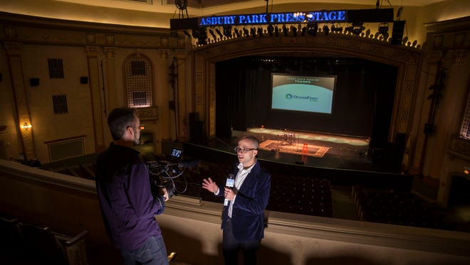 Asbury Park Press features reporter Alex Biese, center, pictured at the Count Basie Theatre on March 7.