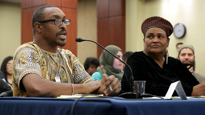 "Muhammad Ali Jr., son of boxing legend Muhammad Ali, and his mother, Khalilah Camacho-Ali, participate in a forum titled ""Ali v. Trump: The Fight for American Values"" about immigration enforcement with Democratic members of the House at the U.S. Capitol on March 9, 2017."