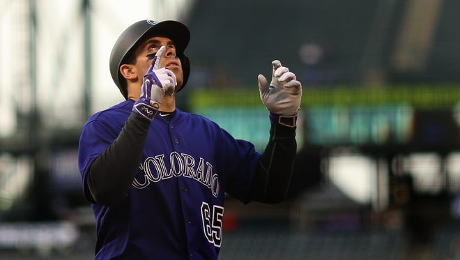 Stephen Cardullo #65 of the Colorado Rockies celebrates his first inning grand slam against the Los Angeles Dodgers at Coors Field on August 31, 2016 in Denver, Colorado. This is Cardullo's second home home run of his career. He made the Rockies' opening day 2017 roster.