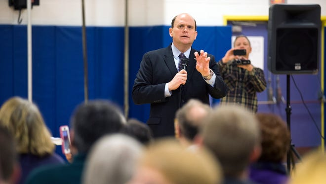 Congressman Tom Reed speaks to a crowd of about 250 people during a town hall meeting at Broadway Academy in Elmira on Saturday, April 1, 2017.