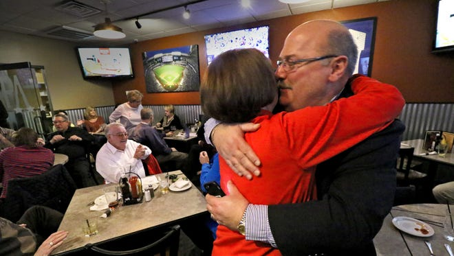 Steve Olson gives his wife Beverly a kiss after receiving word that he was reelected in the Franklin mayoral race on April 4. Unofficial results showed Olson leading challenger Basil Ryan 3,132 to 2,649 votes.