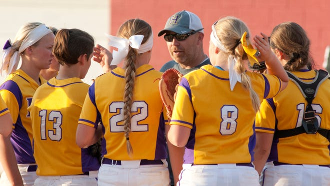 File photo of Male coach Josh Bloomer and the Male softball team.