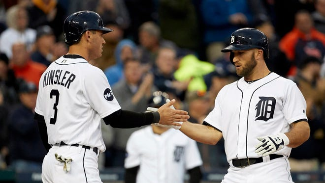 Tyler Collins of the Tigers is congratulated by Ian Kinsler after Collins' three-run home run in the second inning against the Indians at Comerica Park in Detroit.