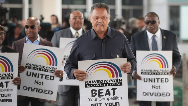Jesse Jackson leads a protest at Chicago airport on April 12, 2017.