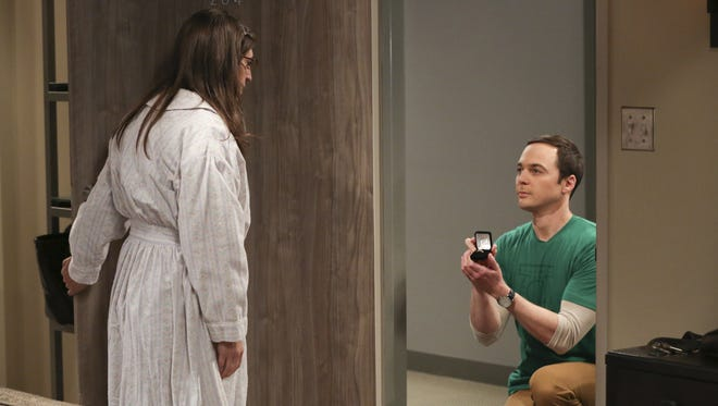 Sheldon (Jim Parsons), right, pops the question to Amy (Mayim Bialik) at the end of the Season 10 finale of CBS's 'The Big Bang Theory.'