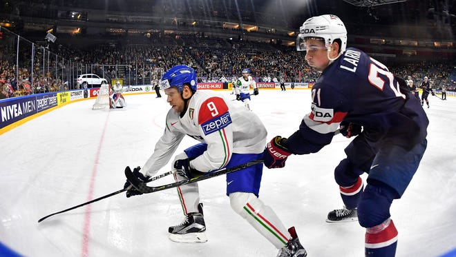 U.S. forward Dylan Larkin (right) in action against Italy defender Armin Hofer during the 2017 IIHF Ice Hockey World Championship group A preliminary round game in Cologne, Germany on May 10, 2017.