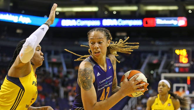 Phoenix Mercury center Brittney Griner (42) drives to the basket against Indiana Fever forward Erlana Larkins (2) during the first half of their WNBA game Wednesday May 17, 2017 in Phoenix, Ariz.