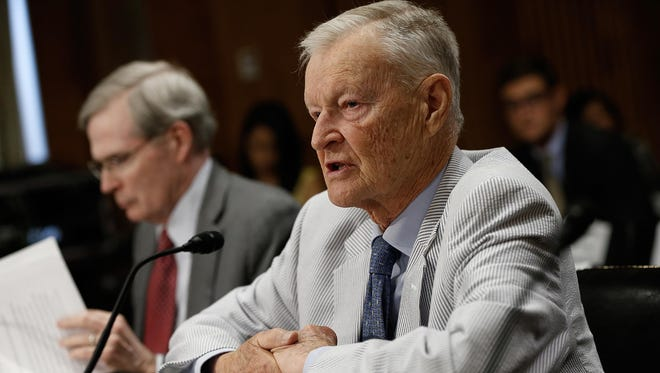 Former National Security Advisor Zbigniew Brzezinski, right, and former assistant to the president for national security affairs Stephen Hadley testify before the Senate Foreign Relations Committee during a hearing July 9, 2014 in Washington, DC.