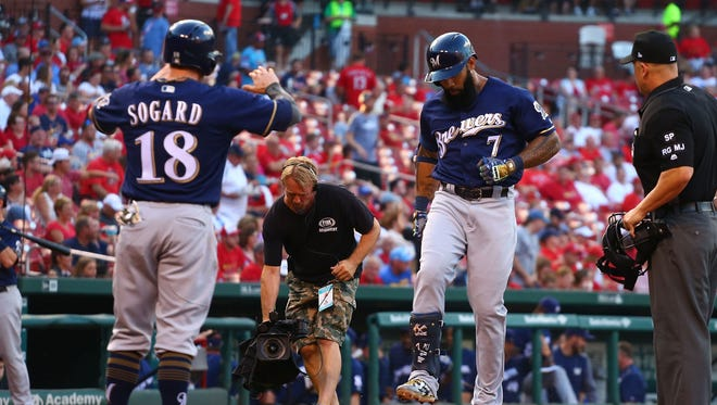 Eric Thames is greeted by Eric Sogard after Thames' two-run home run in the first inning.