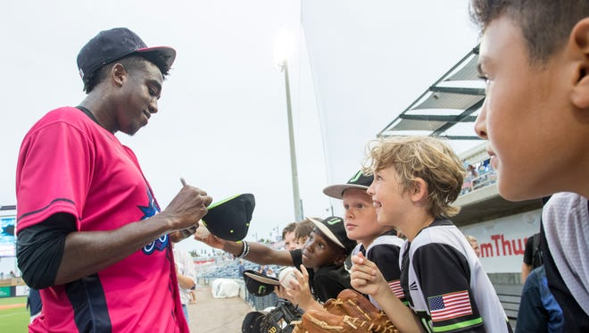The Pensacola Blue Wahoos' Gabriel Guerrero signs autographs after winning the 2017 Southern League All Star Home Run Derby in Pensacola, Florida on Monday, June 19, 2017.