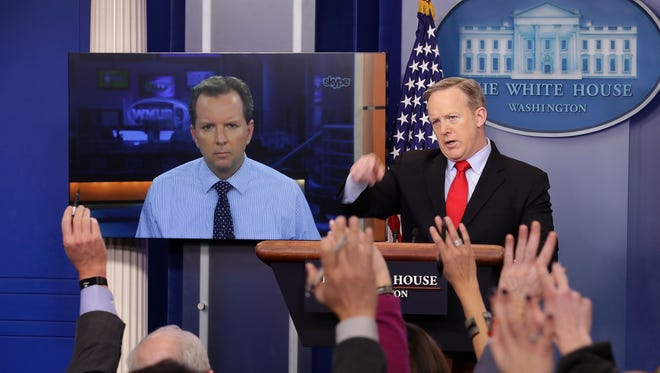 "White House Press Secretary Sean Spicer takes questions from reporters in the Brady Press Briefing Room after answering a question from WMUR's Josh McElveen via Skype at the White House Feb. 3.  Spicer has been taking questions from people via the Internet in order to ""open up the briefing room to journalists who live beyond 50 miles' of Washington."