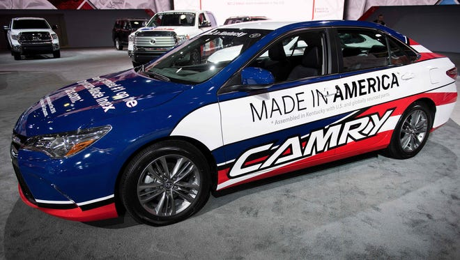 """The Toyota Camry, with lettering on the side stating """"Made in America"""", is assembled in Kentucky, is shown during the 2017 North American International Auto Show in Detroit in January 2017."""