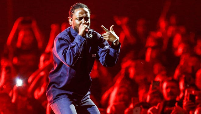 "In this handout photo provided by The Forum, Kendrick Lamar performs his song""Humble""after joining The Weeknd on stage during the ""Legends of The Fall Tour"" on April 29, 2017 at The Forum in Inglewood, California."