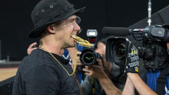 James Foster bites his gold medal for BMX Big Air