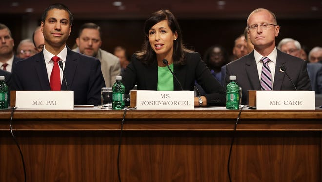 Federal Communications Commission Chairman Ajit Pai and nominees Jessica Rosenworcel and Brendan Carr, left to right, prepare to testify before the Senate Commerce, Science and Transportation Committee during their confirmation hearing July 19, 2017 in Washington, DC. Pai has served as the FCC chairman since January of 2017 and is due for re-appointment.