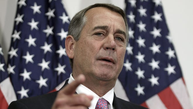 In this Oct. 27, 2015, file photo, outgoing House speaker John Boehner talks with reporters on Capitol Hill.