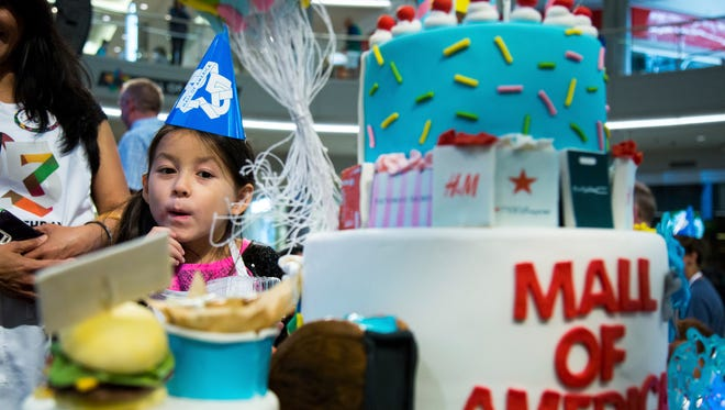 Jaslyn Rutledge looks at the contest cakes during Mall of America's 25th birthday celebration celebration, Friday, Aug. 11, 2017, in Bloomington.