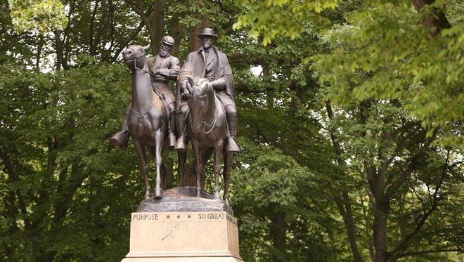 "A monument featuring Thomas J. ""Stonewall"" Jackson, left, and Robert E. Lee stands in Wyman Park in Baltimore, MD near Johns Hopkins University. The monument was a gift from J. Henry Ferguson, a prominent local banker. Jackson and Lee were childhood heroes of Ferguson. The statue was erected in 1948, twenty years after Ferguson's death due to the Great Depression and World War II.  Maryland was a border state during the Civil War. A slave state that did not secede from the Union and did not join the Confederacy."