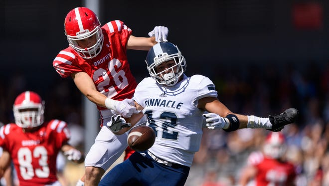 Brophy College Prep's Sully Shannon (#26) breaks up a pass intended for Pinnacle's Hogan Hatten (#42) during the first quarter of the Sollenberger Classic game on Saturday, Aug. 19, 2017, at Coconino High School in Flagstaff, Ariz.