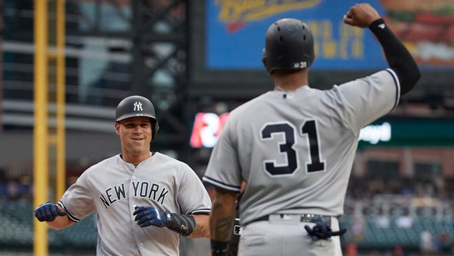 Aug 22, 2017; Detroit, MI, USA; New York Yankees catcher Gary Sanchez (24) receives congratulations from center fielder Aaron Hicks (31) after he hits a two run home run in the first inning against the Detroit Tigers at Comerica Park on Tuesday, Aug. 22, 2017.