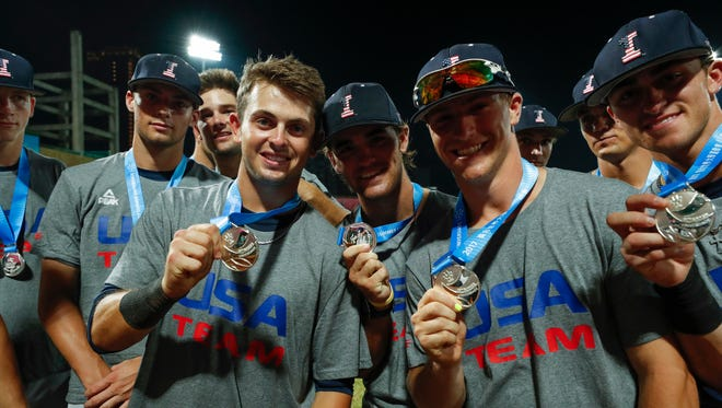 Iowa Hawkeyes infielder Mitchell Boe (4), outfielder Justin Jenkins (6), catcher Tyler Cropley (5) and infielder Tanner Wetrich (16) show off their silver medals during their gold medal game against Japan Tuesday, August 29, 2017 at Tianmu Baseball Stadium in Taipei, Taiwan.