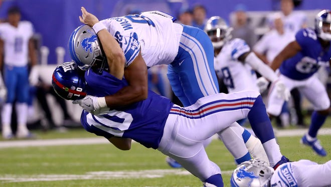 Giants QB Eli Manning is leveled by Lions DE Cornelius Washington in the fourth quarter of the Lions' 24-10 win Monday, Sept. 18, 2017 in East Rutherford, N.J.