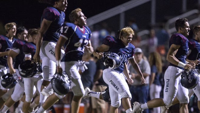 Perry (6-0) celebrates after defeating Highland (5-1) at Perry High School on Friday, Sept. 22, 2017 in Gilbert, Ariz. Perry won, 56-6.