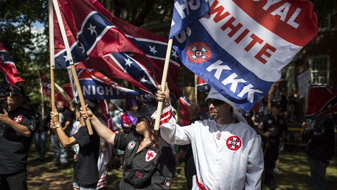 Members of the Ku Klux Klan protest July 8, 2017, in Charlottesville, Va.