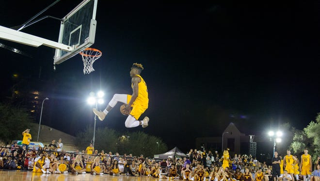 Arizona State University's Zylan Cheatham (#31) gets a perfect score for this slam dunk during Mill Madness on Friday, Oct.13, 2017, at Mill Avenue & 7th St. in Tempe, Ariz.