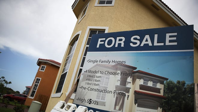 A for sale sign is seen in front of a new home on July 26, 2017 in Miami, Florida.