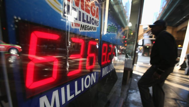 A sign in Chicago advertises a $636 million Mega Millions jackpot on Dec. 17, 2013. Later that day the pot rose to $648 million, and two winning tickets were sold, making it the fourth largest lottery prize in U.S. history.