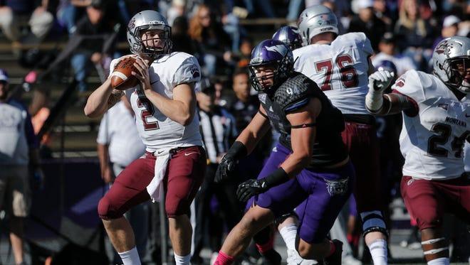 Montana's Gresch Jensen looks to pass against Weber State last fall.